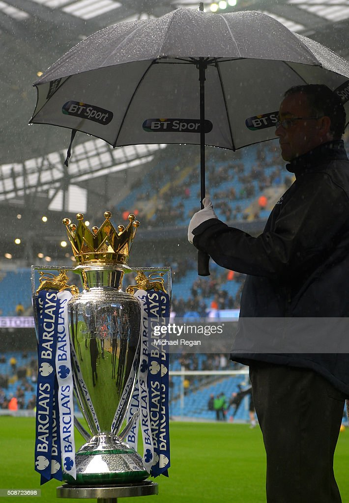 The Premier League Trophy is sheltered from the rain prior to the Barclays Premier League match between Manchester City and Leicester City at the Etihad Stadium on February 6, 2016 in Manchester, England.
