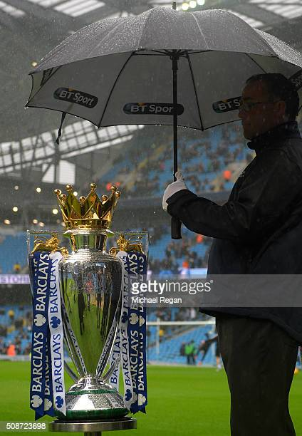 The Premier League Trophy is sheltered from the rain prior to the Barclays Premier League match between Manchester City and Leicester City at the...