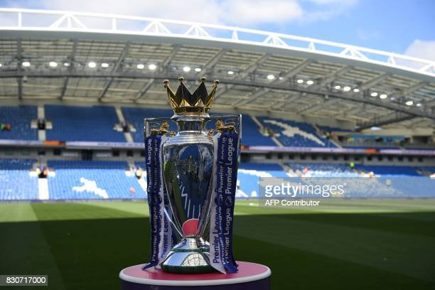 The Premier league trophy sits beside the pitch ahead of the English Premier League football match between Brighton and Hove Albion and Manchester...