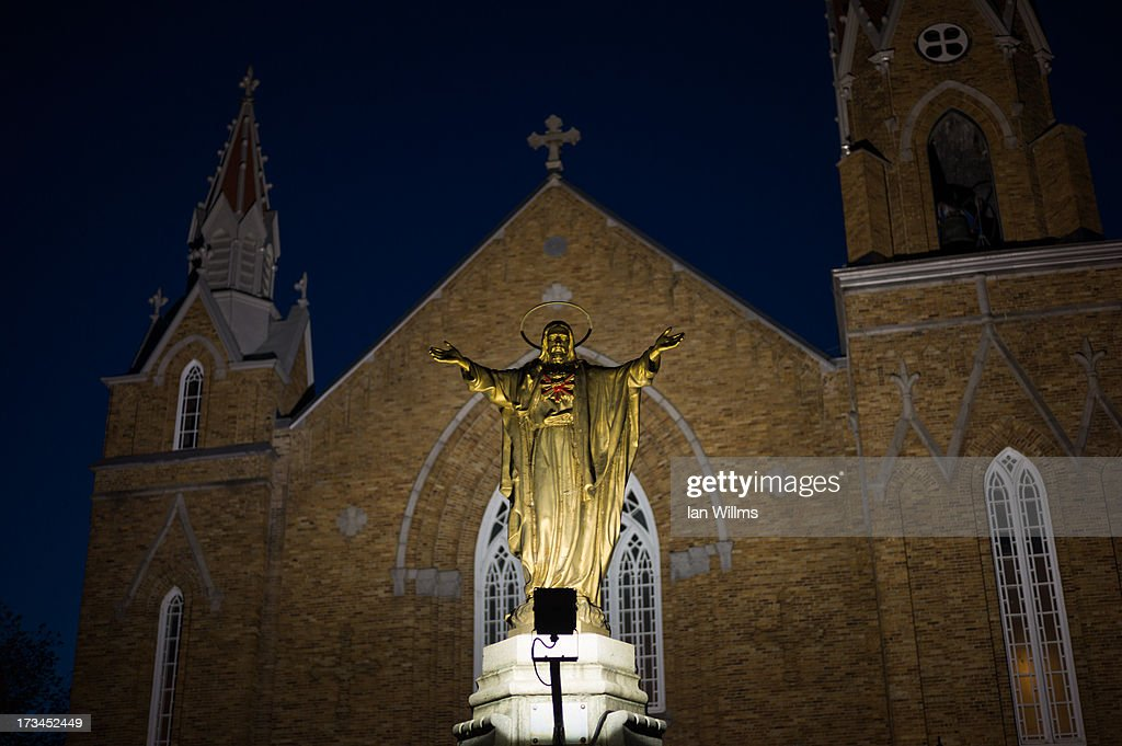 The PresbytresEglises Catholiques on July 13 2013 in LacMegantic Quebec Canada A train derailed and exploded into a massive fire that flattened...