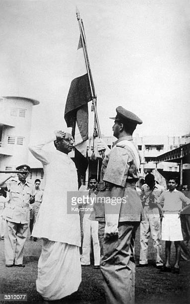 The presentation of colours to the Bombay Home Guard part of the celebrations of Indian Independence Day at Bombay B G Kher Bombay Premier salutes...