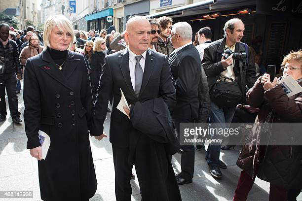 The presenter of the French reality show Dropped Louis Bodin and his wife Claire Depeuille Bodin are seen during the funeral ceremony of competitive...