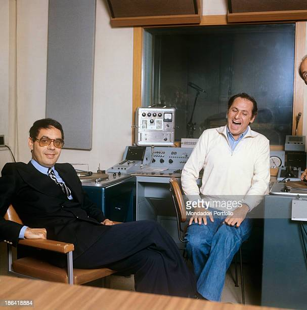 The presenters and star performers Renzo Arbore and Gianni Boncompagni relax and have fun in a pause during the radio broadcast Alto Gradimento Rome...