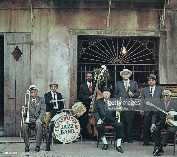 The Preservation Hall Jazz Band pose outside Preservation Hall in New Orleans circa 1970