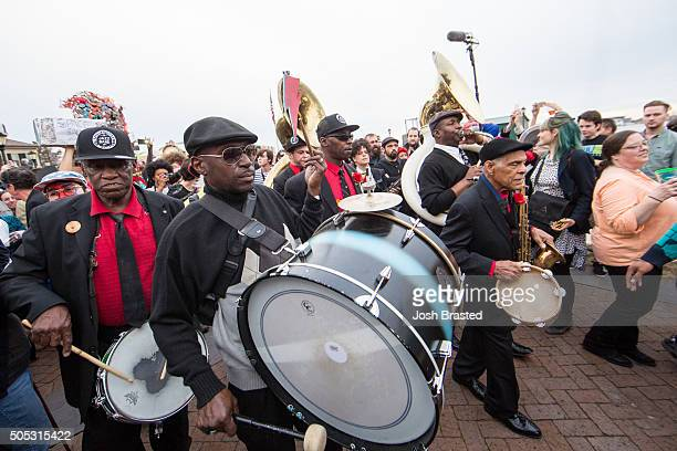 The Preservation Hall Jazz Band takes part in a second line honoring David Bowie through the French Quarter on January 16 2016 in New Orleans...