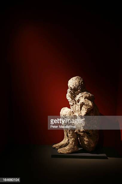 The preserved body of a mule driver in a crouching position is shown at the Life And Death In Pompeii And Herculaneum exhibition at The British...
