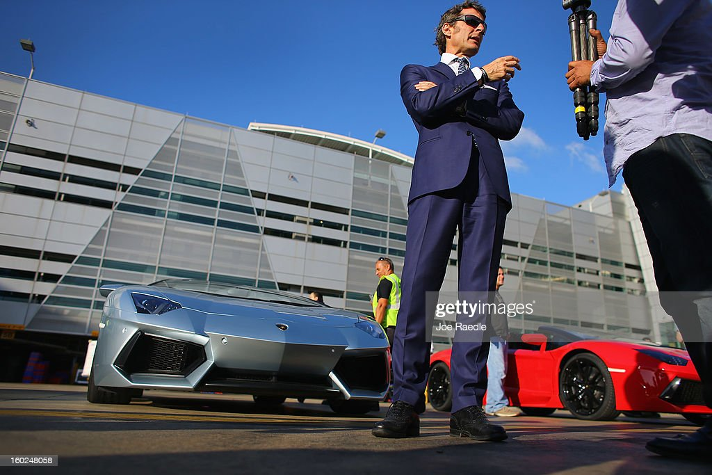 The President and CEO of Lamborghini Stephan Winkelmann stands near the new Lamborghini Aventador LP700-4 Roadster at the Miami International Airport on January 28, 2013 in Miami, Florida. The world wide unveiling of the new luxury super sports cars took place at the airport.