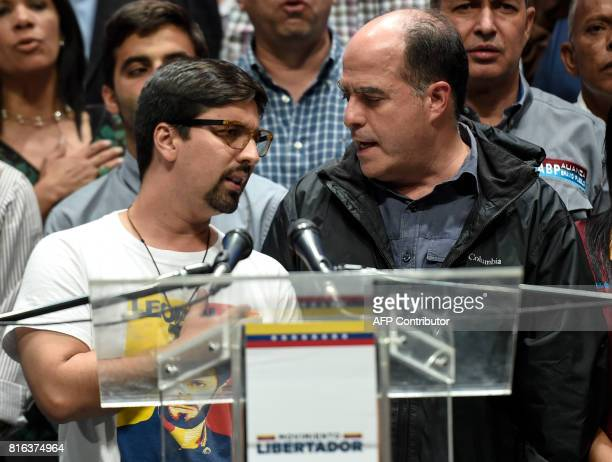 The president and vicepresident of Venezuela's National Assembly Julio Borges and Freddy Guevara respectively address the crowd during a meeting in...