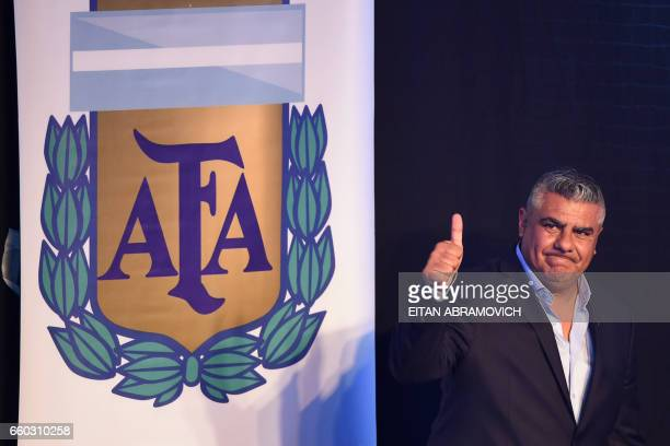 The president of Argentinian football team Barracas Central Claudio Tapia gives the thump up after being elected President of Argentina's Football...