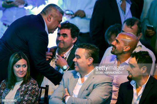 The president of Argentinian football team Barracas Central Claudio Tapia greets player and president of Estudiantes de La Plata Juan Sebastian Veron...