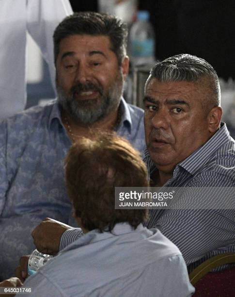 The president of Argentinian football team Boca Juniors Daniel Angelici and of Barracas Central Claudio Tapia chat during a meeting at Argentina's...