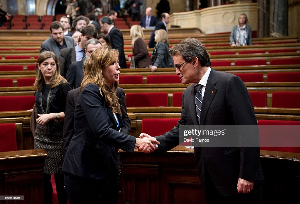 The President of Catalonia Artur Mas shakes hands with the President of the right wing Popula Party of Catalonia Alicia Sanchez Camacho after being...