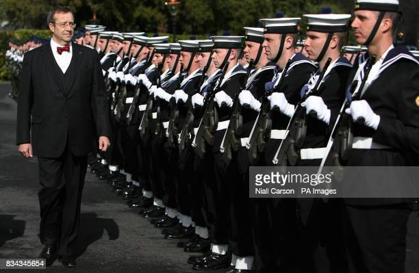 The President of Estonia Toomas Hendrik Ilves reviews Irish sailors at Aras an Uachtarain as he begins a threeday State visit to Ireland