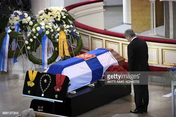 The president of Finland Sauli Niinistoe pays tribute next to the coffin of Finland's former President Mauno Koivisto during a state funeral ceremony...