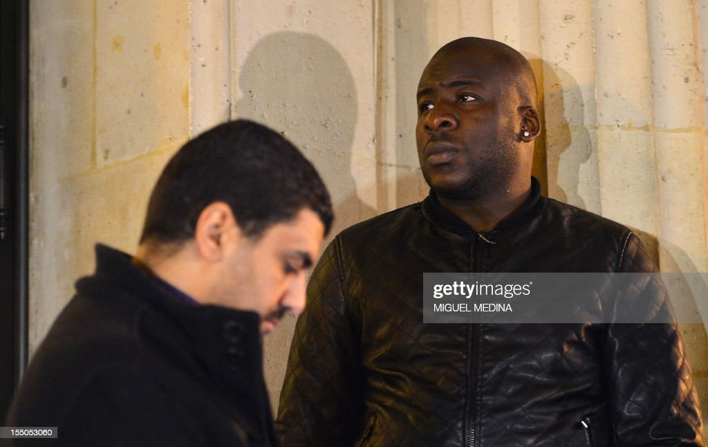 The president of French association 'Au dela des mots' (Beyond words) Samir Mihi (L) and Siyakha Traore, Bouna's elder brother wait outside a courtroom at the Cour of Cassation, France's highest court, in Paris on October 31, 2012. The court cancelled a previous dismissal in the case of the two police officers involved in the death of Bouna Traore and Zyed Benna in 2005. These two French teenagers of African origin died on October 27, 2005, after being electrocuted in a sub-station while fleeing from the police. The death of the two boys started the country's worst urban unrest since the 1968 student revolts.