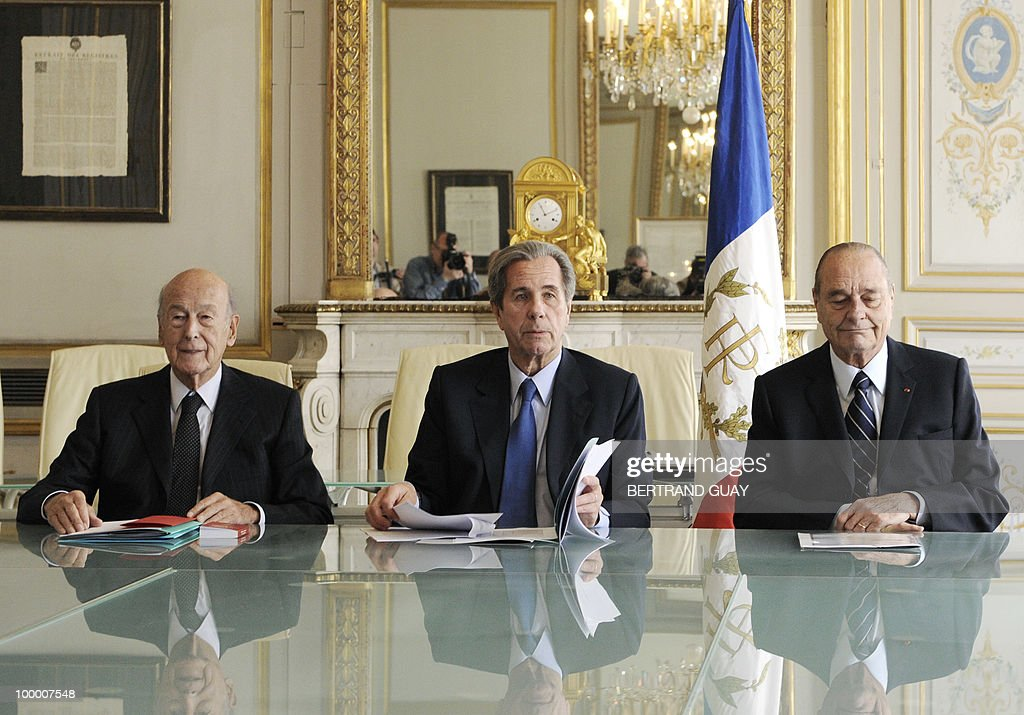The President of French Constitutional Council (Conseil Constitutionnel) Jean-Louis Debre (C) and the two former French Presidents members, Valery Giscard d'Estaing (L) and Jacques Chirac, pose on May 20, 2010 at the Council in Paris.