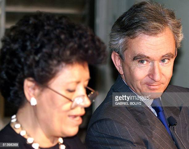 The President of French luxury good maker LVMH Bernard Arnault looks at Fendi's President Carla Fendi during a press conference in Rome 23 November...