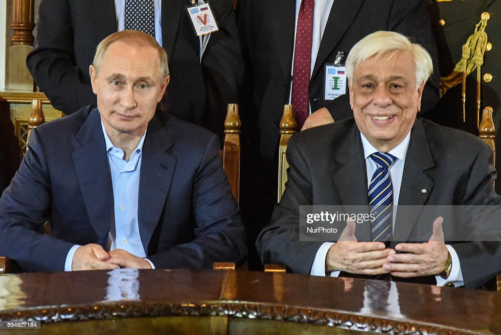 The President of Greece, <a gi-track='captionPersonalityLinkClicked' href=/galleries/search?phrase=Prokopis+Pavlopoulos&family=editorial&specificpeople=4517908 ng-click='$event.stopPropagation()'>Prokopis Pavlopoulos</a> (R) welcomes the president of the Russian Federation, Vladimir Putin (L), in Mount Athos, Greece on May 28, 2016.