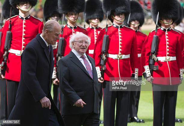 The President of Ireland Michael D Higgins inspects a Guard of Honour with Prince Phillip Duke of Edinburgh at Windsor Castle on April 8 2014 in...