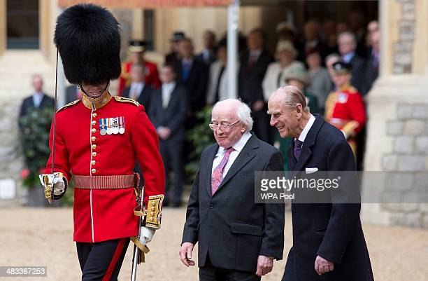 The President of Ireland Michael D Higgins prepares to inspect a Guard of Honour with Prince Philip Duke of Edinburgh at Windsor Castle on April 8...