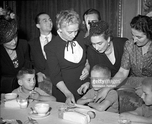 The President of Italian Republic Luigi Einaudi's wife Ida Pellegrini housing at the Quirinale for one day some children mutilated by war helped by...
