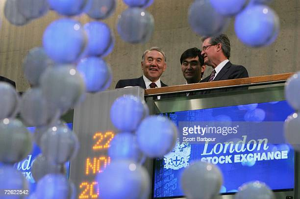 The President of Kazakhstan Nursultan Nazarbayev smiles as he opens trading watched by Chris GibsonSmith Chairman of the London Stock Exchange at the...