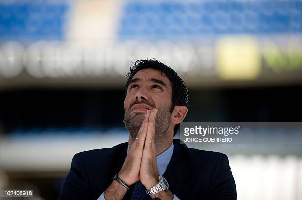 The President of Malaga's football club Fernando Sanz gestures during the presentation ofSheikh Abdallah Ben Nasser AlThani a member of the Qatari...