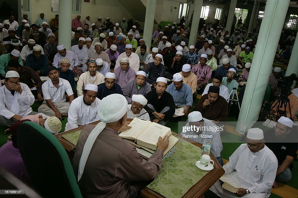 The president of Malaysian Pan Islamic Party, Hadi Awang delivers his weekly Friday sermon to his followers and students on April 26, 2013 in Rusila, Malaysia. Malaysia's 13th general election will be held on May 5.