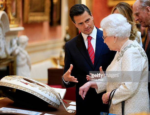 The President of Mexico Enrique Pena Nieto is shown Mexican items in the Royal Collection by Queen Elizabeth II at Buckingham Palace on March 3 2015...