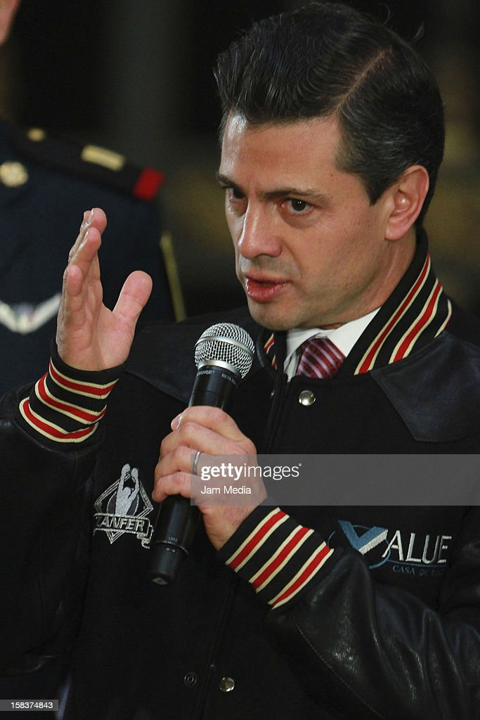 The President of Mexico <a gi-track='captionPersonalityLinkClicked' href=/galleries/search?phrase=Enrique+Pena+Nieto&family=editorial&specificpeople=5957985 ng-click='$event.stopPropagation()'>Enrique Pena Nieto</a> speaks at Palacio Nacional on December 14, 2012 in Mexico City, Mexico