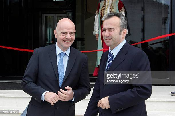 The president of Montenegro's Football Association Dejan Savicevic and FIFA President Gianni Infantino attend the inauguration ceremony of the House...