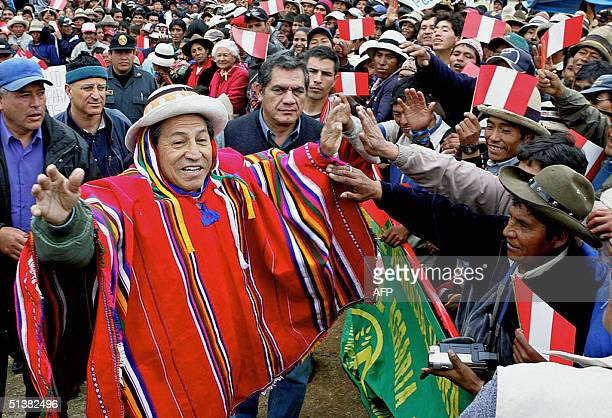 The President of Peru Alejandro Toledo greets local residents in Las Bambas in Apurimac 1100 Km southeast of Lima 01 October 2004 after receiving a...