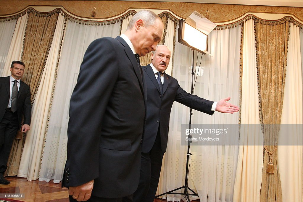 The President of Russia Vladimir Putin is greeted by the President of Belarus Alexander Lukashenko on May 31 2012 in Minsk Belarus