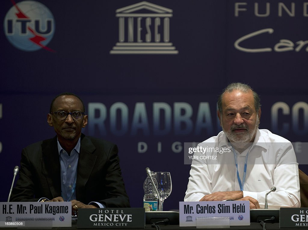 The President of Rwanda Paul Kagame and Mexican tycoon Carlos Slim attend the Broadband Commission for Digital Development meeting in Mexico City on March 17, 2013. AFP PHOTO/Yuri CORTEZ