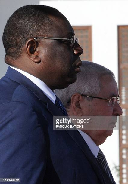 The president of Senegal Macky Sall and Algeria's President of the Council of the Nation Abdelkader Bensalah attend a welcome ceremony upon Sall's...