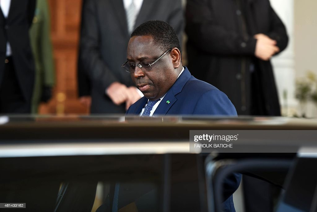 The president of Senegal, <a gi-track='captionPersonalityLinkClicked' href=/galleries/search?phrase=Macky+Sall&family=editorial&specificpeople=598630 ng-click='$event.stopPropagation()'>Macky Sall</a> leaves Houari Boumediene airport at the end of a welcome ceremony on January 12, 2015 on the outskirts of the capital Algiers. Sall is on a four-day visit to the country.