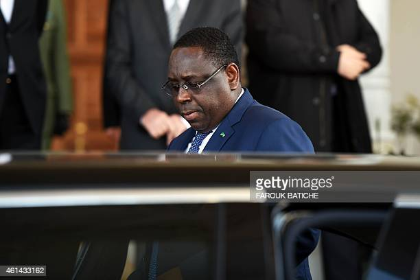 The president of Senegal Macky Sall leaves Houari Boumediene airport at the end of a welcome ceremony on January 12 2015 on the outskirts of the...