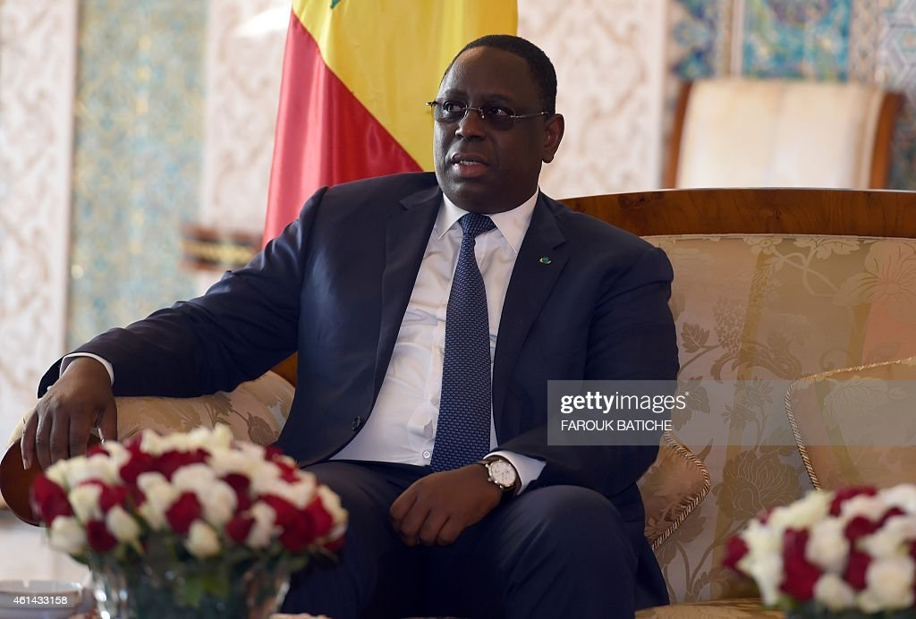The president of Senegal, <a gi-track='captionPersonalityLinkClicked' href=/galleries/search?phrase=Macky+Sall&family=editorial&specificpeople=598630 ng-click='$event.stopPropagation()'>Macky Sall</a> looks on as he meets with Algeria's President of the Council of the Nation Abdelkader Bensalah (unseen) during a welcome ceremony at Houari Boumediene airport on the outskirts of the capital Algiers on January 12, 2015. Sall is on a four-day visit to the country. AFP PHOTO / FAROUK BATICHE