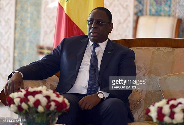 The president of Senegal Macky Sall looks on as he meets with Algeria's President of the Council of the Nation Abdelkader Bensalah during a welcome...