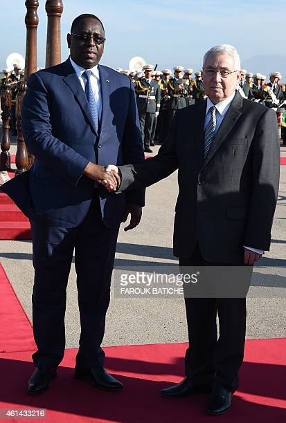 The president of Senegal Macky Sall shakes hands with Algeria's President of the Council of the Nation Abdelkader Bensalah during a welcome ceremony...