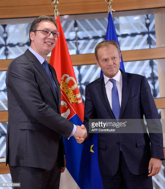 The President of Serbia Aleksandar Vucic shakes hands with European Union Council President Donald Tusk prior to their meeting at the European Union...