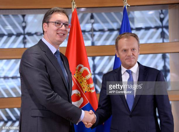 The President of Serbia Aleksandar Vucic shakes hands with European Union Council President Donald Tusk at the European Union Council building in...
