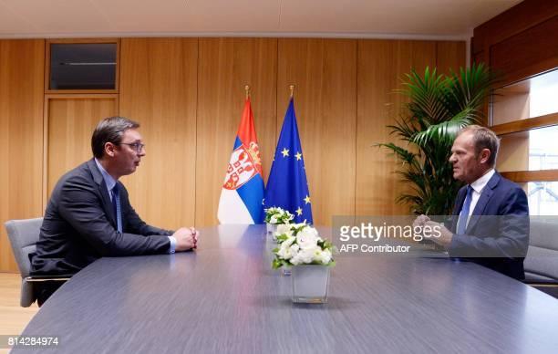 The President of Serbia Aleksandar Vucic speaks with European Union Council President Donald Tusk at the European Union Council building in Brussels...