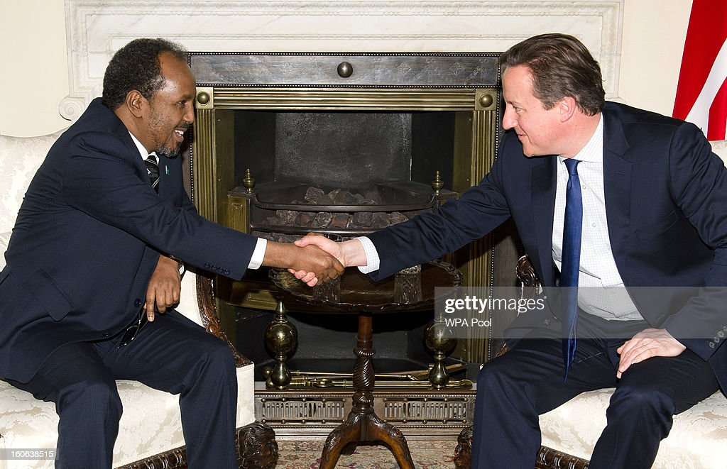 The President Of Somalia, <a gi-track='captionPersonalityLinkClicked' href=/galleries/search?phrase=Hassan+Sheikh+Mohamud&family=editorial&specificpeople=10123535 ng-click='$event.stopPropagation()'>Hassan Sheikh Mohamud</a> (L), meets with British Prime Minister <a gi-track='captionPersonalityLinkClicked' href=/galleries/search?phrase=David+Cameron+-+Politician&family=editorial&specificpeople=227076 ng-click='$event.stopPropagation()'>David Cameron</a> at 10 Downing Street on February 4, 2013 in London, England. The UK is to give an aid package of nearly 3 million GBP to the Somali government for the feeding of malnourished citizens.