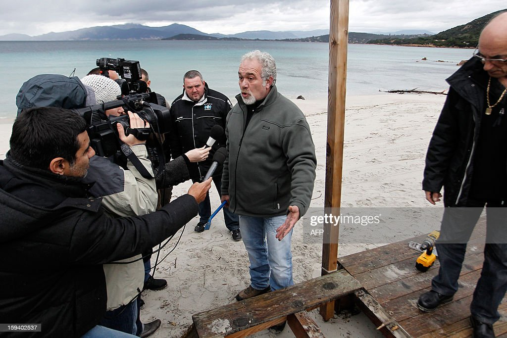 The president of the beach huts protection group and owner of the 'Beach Hut of the Silver Beach' restaurant, Ange Istria talks to the press on January 13, 2013 in Porticcio. The South Corsica prefecture has ordered beach hut owners to demolish the parts that are located on the public property before January 15. If not respected the prefecture will conduct the demolition itself.