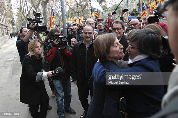 The President of the Catalan Parliament Carme Forcadell accompanied by hundreds of members of the Parliament and mayors salutes when she leaves from...