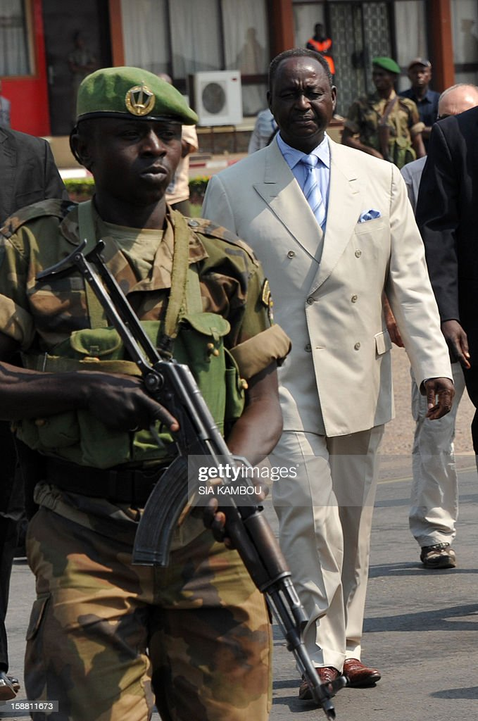 The President of the Central African Republic, Francois Bozize (C), arrives at the airport in Bangui on December 30, 2012, to meet the current president of the African Union, the President of Benin, for talks over the current crisis. Rebels in the Central African Republic who have advanced towards the capital Bangui warned they could enter the city even as the head of the African Union prepared to launch peace negotiations. Central African President Francois Bozize also stated today he was open to a national unity government after talks with rebel leaders and that he would not run for president in 2016. AFP PHOTO/ SIA KAMBOU