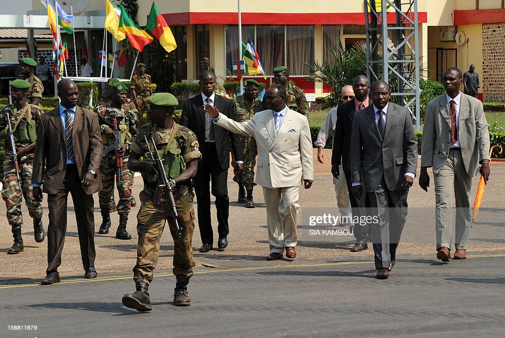 The President of the Central African Republic, Francois Bozize (Center L), arrives at the airport in Bangui on December 30, 2012, to meet the current president of the African Union, the President of Benin, for talks over the current crisis. Rebels in the Central African Republic who have advanced towards the capital Bangui warned they could enter the city even as the head of the African Union prepared to launch peace negotiations. Central African President Francois Bozize also stated today he was open to a national unity government after talks with rebel leaders and that he would not run for president in 2016.