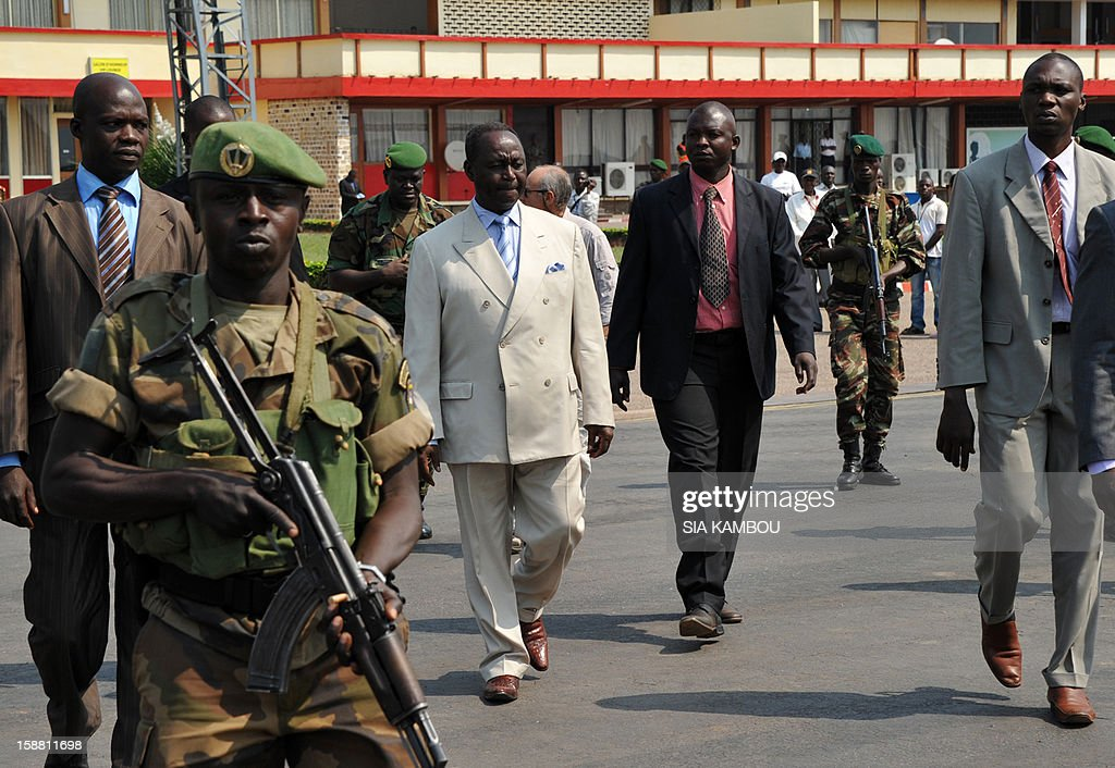 The President of the Central African Republic, Francois Bozize (3rd L), arrives at the airport in Bangui on December 30, 2012, to meet the current president of the African Union, the President of Benin, for talks over the current crisis. Rebels in the Central African Republic who have advanced towards the capital Bangui warned they could enter the city even as the head of the African Union prepared to launch peace negotiations. Central African President Francois Bozize also stated today he was open to a national unity government after talks with rebel leaders and that he would not run for president in 2016. AFP PHOTO/ SIA KAMBOU