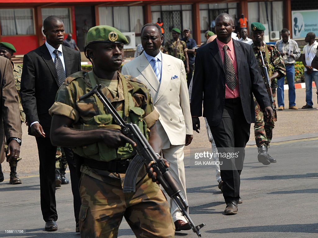 The President of the Central African Republic, Francois Bozize (C), arrives at the airport in Bangui on December 30, 2012, to meet the current president of the African Union, the President of Benin...